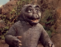 All Monsters Attack - Minilla stares intently.png