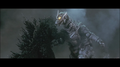 GMMG - Kiryu stabbing his Drill Hand onto Godzilla.png