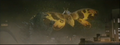 Mothra attacks Godzilla with scales.png