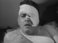 Godzilla-King-of-the-Monsters-Raymond-Burr-wounded.png