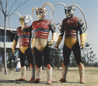 A Gold Garoga and two Silver Garogas in Zone Fighter