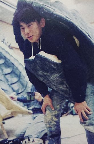 Hidenori Yamaoka test-fitting Gamera's shell for Gamera: Guardian of the Universe