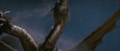 Ouch! Ghidorah is hurt by the rock!.png