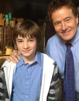 CJ Adams and Bryan Cranston in an on-set photo for Godzilla