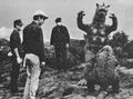 AMA - A Frightened Minilla and Gabara Infront of Three Men.jpg