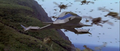 Godzilla vs. Megaguirus - Hundreds of Meganulas fly past the Griffon.png