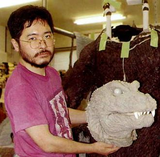 Fuyuki Shinada holding the head of the GMKGoji