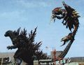 GXM - Godzilla Grabs Megaguirus With His Tail.jpg