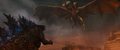GKOTM - King Ghidorah flying over to pick up Godzilla.png